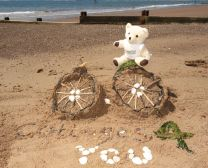 Build us your best sandcastle or for the more adventurous……a sand sculpture