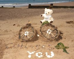 Build us your best sandcastle or for the more adventurous……a sand sculpture