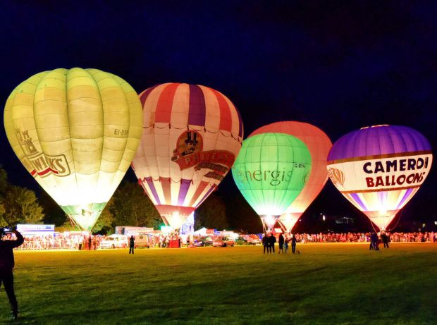 "Second place 'night glow balloons' by Raymond Watson. Raymond says: ""This was taken at Strathaven balloon festival."" Our judge says: ""The contrast between light and dark brings this photo to life and I really like that you get the scale of these enormous hot air balloons."""