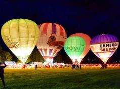 """Second place 'night glow balloons' by Raymond Watson. Raymond says: """"This was taken at Strathaven balloon festival."""" Our judge says: """"The contrast between light and dark brings this photo to life and I really like that you get the scale of these enormous hot air balloons."""""""