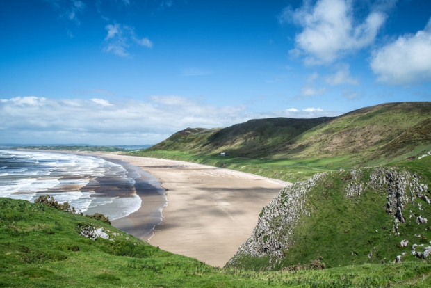 Beautiful Summer landscape of Rhosilli Bay beach Gower peninsula